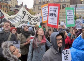 Students rallied at Union Square Park during the Occupy day of action before marching to Foley Square (Ianqui Doodle)