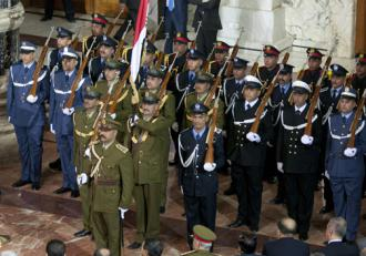 Representatives of Iraqi military and security forces at a ceremony in Baghdad (Staff Sgt. Caleb Barrieau)