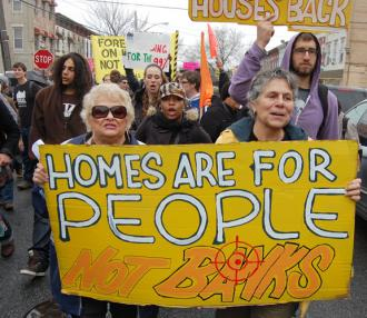 Protesters march through Brooklyn on their way to help a homeless family reclaim a foreclosed home