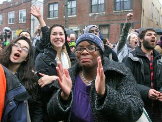 Occupy Wall Street rallying in support of a home reclaimed from foreclosure (Brennan Cavanaugh)