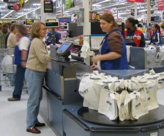A Wal-Mart worker at the checkout line