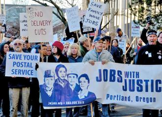 Postal workers and supporters rally against proposed cuts in Portland, Ore.