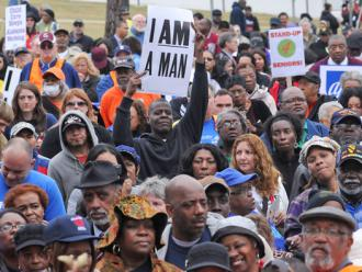 Thousands join in a rally outside the Alabama State Capitol building in defense of voters, workers and immigrant rights (David Bundy)