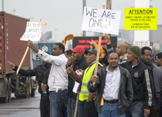 Striking truck drivers picket the Port of Seattle on February 8 (David Bacon)