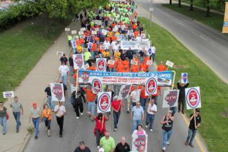 Labor activists and supporters un-welcome Mitch Daniels during his visit to Champaign, Illinois