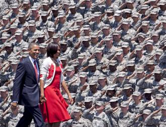 Barack and Michelle Obama are greeted by troops during a visit to Fort Stewart (Sgt. Uriah Walker)
