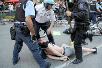 Police arrest a protester in Chicago during a mass anti-NATO march