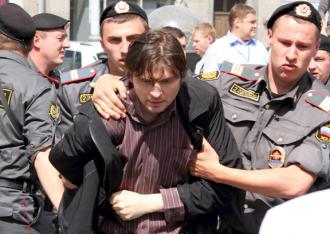 Russian police arrest an LGBT rights protester at a demonstration in May (Sergey Kukota)
