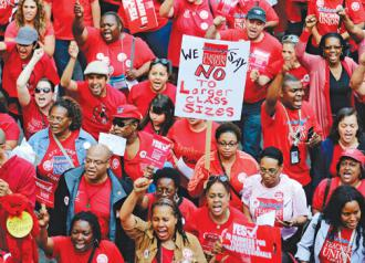 Chicago teachers took to the streets of downtown to demand a fair contract