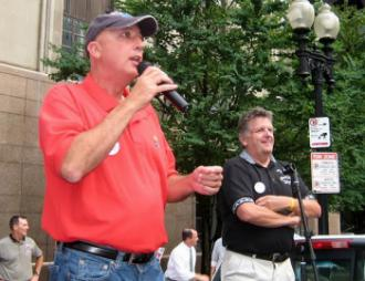 Opposition candidate Don Trementozzi speaks at a CWA rally at Verizon