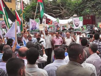 Residents of Gaza campaign for justice for Palestinian prisoners on hunger strike, including Samer Issawi (Joe Catron)
