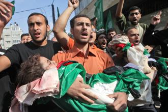Residents of Gaza City carry the victims of the Israeli assault on Palestinians