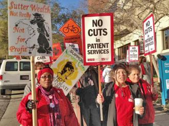 Nurses walk the picket line at Sutter on Christmas Eve