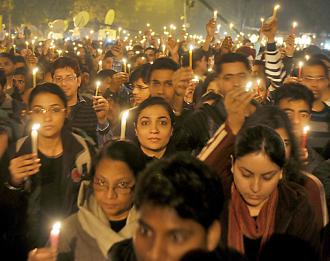 Protesters march in Delhi after the death of a 23-year-old victim of gang rape