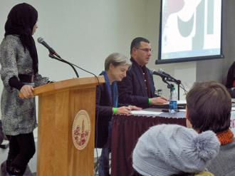 Panelists Judith Butler and Omar Barghouti (seated, left to right) speak out at Brooklyn College