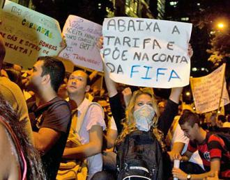 Protesters pack the streets of Rio de Janeiro to protest the upcoming World Cup