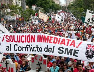 Electrical workers and teachers join in a mass march in Mexico City