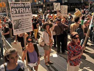 Protesters in New York City march against U.S. threats to attack Syria (Asterio Tecson)