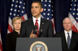 President Barack Obama, flanked by Secretary of State Hillary Clinton and Defense Secretary Robert Gates (Lawrence L. Jackson)