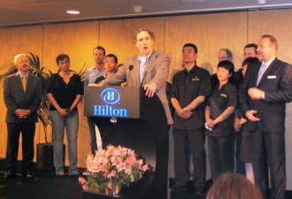 HERE Local 2 President Mike Casey talks about an agreement with Hilton, flanked by San Francisco Mayor Ed Lee (far left) and Hilton Union Square GM Michael Dunne (Carl Finamore)