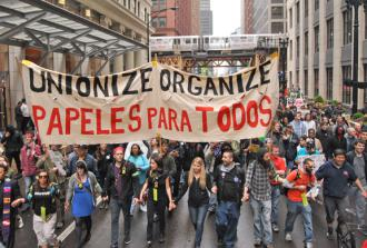 Protesters march through the rain in Chicago on May Day 2012 (Mario Garcia-Baeza | SW)