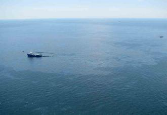 Ships attempt to clean up spilled oil from the Gulf of Mexico where a BP drilling platform exploded and sank