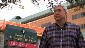 Surgeon Dr. John Bagnato stands outside Puntney Memorial Hospital in Albany, Ga.