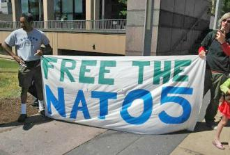 Supporters rally in defense of the NATO Five