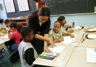 A teacher works with students at a school in Harlem (Richard B. Levine | Showcase)