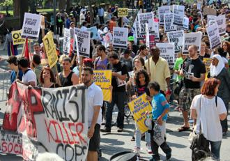 Some 15,000 people filled Fifth Avenue for the silent march against the NYPD's stop-and-frisk policy (Adriano Contreras)
