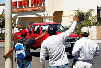 Laborers hope for a day's work in a Home Depot parking lot