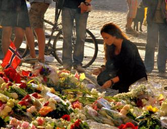 A tribute of flowers and candles in Oslo to remember the victims of a right-wing terror attack