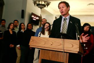Whole Foods CEO John Mackey addresses a press conference about healthy eating