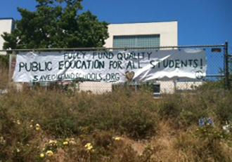 A banner hangs outside the sit-in at Lakeview Elementary in Oakland (Jessie Muldoon | SW)