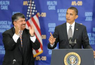 AFL-CIO President Richard Trumka cheers on a speech by President Obama