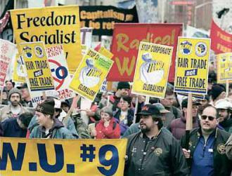 Global justice demonstrators march against the WTO in Seattle