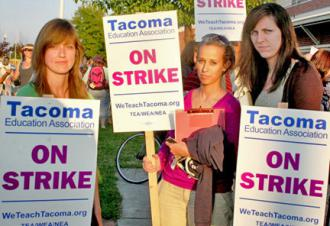 Tacoma teachers on the picket line in defiance of a judge's injunction