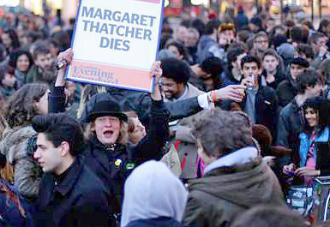 A crowd in Brixton greets the news of Margaret Thatcher's death