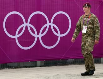 A British soldier patrols an Olympic site