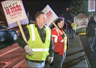 Members of Teamsters Local 117 walk the picket line at United Natural Foods Inc.