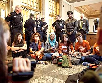 Eighteen student activists were arrested on April 18, 2012, while sitting in to demand that UT stop using sweatshop labor