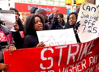 Wendy's employees rally outside their workplace during the November 29 day of action