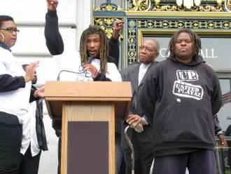 Fly Benzo speaking at a protest outside San Francisco's City Hall (Indybay.org)