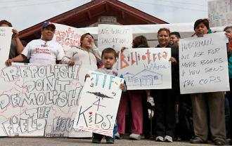 Pilsen parents and community members rally outside the field house they're fighting to save