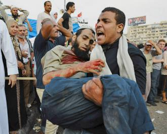 A victim of security forces that opened fire on protesters outside the Rabaa al-Adawiya mosque in Cairo (Mustafa Ozturk | ABACA Press)