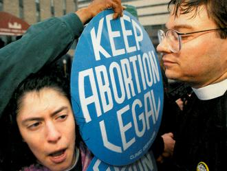 Abortion rights activists clash with anti-choice Operation Rescue members outside the Buffalo clinic