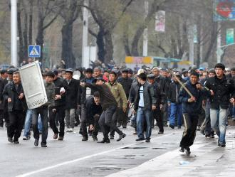 Opposition demonstrators during a confrontation with riot police in the capital of Bishkek (Vyacheslav Oseledko | AFP)