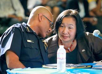 Oakland Mayor Jean Quan confers with Police Chief Howard Jordan