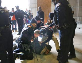 University police arrest protesters sitting in for a trauma center on Chicago's South Side