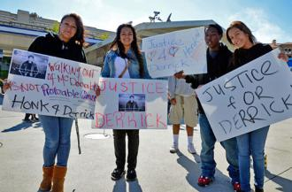 Protesters rally for justice for Derrick near the gas station where he was confronted by police (Alex Darocy | Indybay.org)
